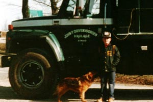 John Duivenvoorden Jr., Jody the dog, and a dump truck.